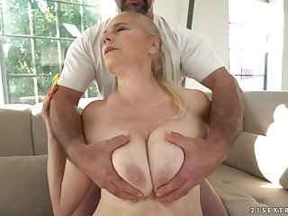 Mega busty granny Violett hooks up with young dude while her husband is out